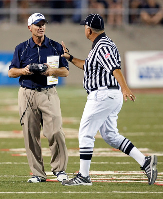 LAS VEGAS - OCTOBER 02:  Nevada Reno Wolf Pack head coach Chris Ault talks to an official during a game against the UNLV Rebels at Sam Boyd Stadium October 2, 2010 in Las Vegas, Nevada. Nevada Reno won 44-26.  (Photo by Ethan Miller/Getty Images)