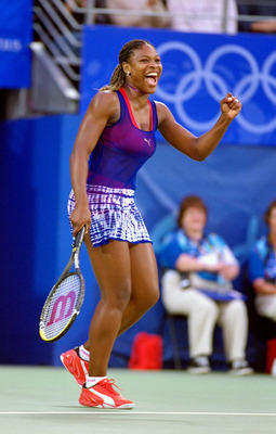 28 Sep 2000:  Serena Williams of the USA celebrates gold after winning the Womens Doubles Tennis Final at the NSW Tennis Centre on Day 13 of the Sydney 2000 Olympic Games in Sydney, Australia. \ Mandatory Credit: Gary M Prior/Allsport