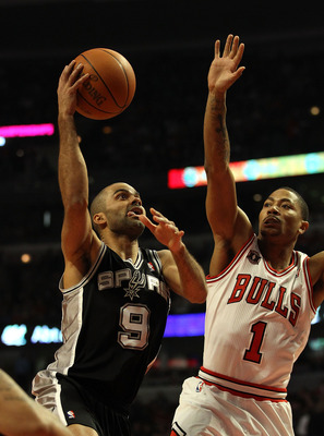 CHICAGO, IL - FEBRUARY 17: Tony Parker #9 of the San Antonio Spurs goes up for a shot against Derrick Rose #1 of the Chicago Bulls at the United Center on February 17, 2011 in Chicago, Illinois. NOTE TO USER: User expressly acknowledges and agrees that, b