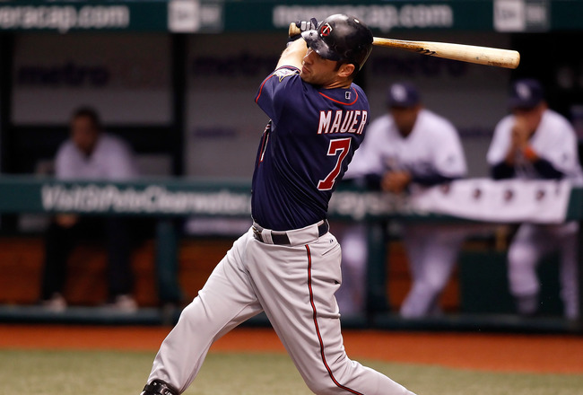 ST. PETERSBURG - AUGUST 04:  Designated hitter Joe Mauer #7 of the Minnesota Twins fouls off a pitch against the Tampa Bay Rays during the game at Tropicana Field on August 4, 2010 in St. Petersburg, Florida.  (Photo by J. Meric/Getty Images)