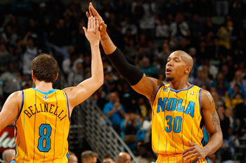 NEW ORLEANS, LA - JANUARY 22:  David West #30 and Marco Belinelli #8 of the New Orleans Hornets celebrate during the game against the San Antonio Spurs at the New Orleans Arena on January 22, 2011 in New Orleans, Louisiana.  The Hornets defeated the Spurs