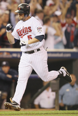 MINNEAPOLIS - OCTOBER 06:  Michael Cuddyer #5 of the Minnesota Twins celebrates his two run homer against the New York Yankees during game one of the ALDS on October 6, 2010 at Target Field in Minneapolis, Minnesota.  (Photo by Elsa/Getty Images)