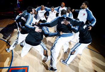CHARLOTTE, NC - NOVEMBER 06:  The Charlotte Bobcats huddle before the start of their game against the Atlanta Hawks at Time Warner Cable Arena on November 6, 2009 in Charlotte, North Carolina.  NOTE TO USER: User expressly acknowledges and agrees that, by