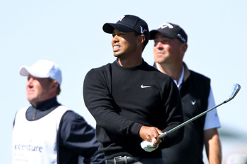 MARANA, AZ - FEBRUARY 23:  Tiger Woods (C) hits his tee shot on the third hole as Thomas Bjorn of Denmark (R) looks on during the first round of the Accenture Match Play Championship at the Ritz-Carlton Golf Club on February 23, 2011 in Marana, Arizona.