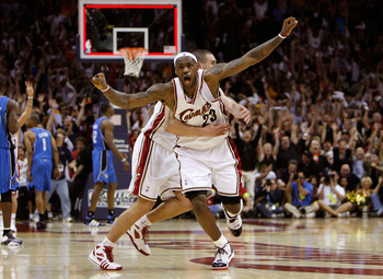 CLEVELAND - MAY 22: LeBron James #23 and Sasha Pavlovic #3 of the Cleveland Cavaliers celebrate after James made the game winning three pointer against the Orlando Magic in Game Two of the Eastern Conference Finals during the 2009 Playoffs at Quicken Loan