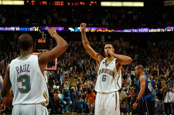 NEW ORLEANS - APRIL 29:  Tyson Chandler #6 and Chris Paul #3 of the New Orleans Hornets celebrate after defeating the Dallas Mavericks in Game Five of the Western Conference Quarterfinals during the 2008 NBA Playoffs at The New Orleans Arena April 29, 200