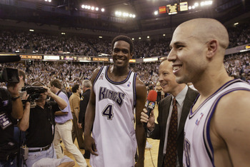 SACRAMENTO, CA - MAY 28:  Broadcaster Jim Gray of NBC interviews point guard Mike Bibby #10 and forward Chris Webber #4 of the Sacramento Kings after the Kings won Game five of the Western Conference Finals against the Los Angeles Lakers during the 2002 N