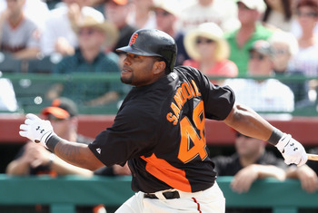 SCOTTSDALE, AZ - MARCH 01:  Pablo Sandoval #48 of the San Francisco Giants hits an RBI double against the Chicago Cubs during the second inning of the spring training game at Scottsdale Stadium on March 1, 2011 in Scottsdale, Arizona.  (Photo by Christian