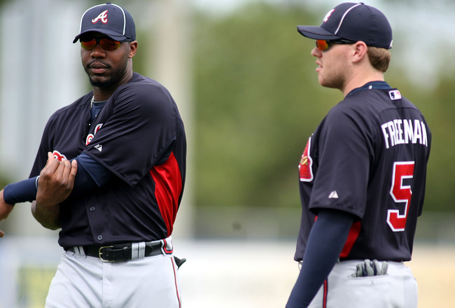 PORT ST. LUCIE, FL - FEBRUARY 26:  Jason Heyward #22 and Freddie Freeman #5 of the Atlanta Braves swarm up prior to playing against the New York Mets at Digital Domain Park on February 26, 2011 in Port St. Lucie, Florida.  (Photo by Marc Serota/Getty Imag