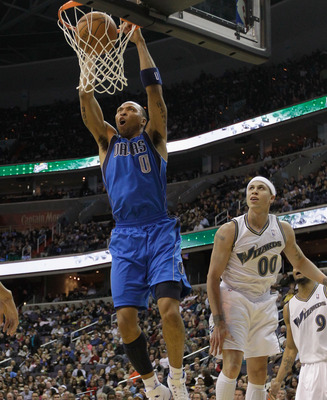 WASHINGTON, DC - FEBRUARY 26: Shawn Marion #0 of the Dallas Mavericks shoots over the defense of Mike Bibby #00 and JaVale McGee #34 of the Washington Wizards at the Verizon Center on February 26, 2011 in Washington, DC. NOTE TO USER: User expressly ackno