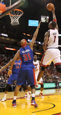 MIAMI, FL - DECEMBER 01: Chris Bosh #1 of the Miami Heat shoots over Charlie Villanueva #31 of the Detroit Pistons during a game at American Airlines Arena on December 1, 2010 in Miami, Florida. NOTE TO USER: User expressly acknowledges and agrees that, b