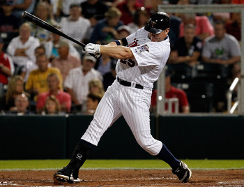 FORT MYERS, FL - FEBRUARY 27:  Designated hitter Jim Thome #25 of the Minnesota Twins fouls off a pitch during a game against the Boston Red Sox during a Grapefruit League Spring Training Game at Hammond Stadium on February 27, 2011 in Fort Myers, Florida