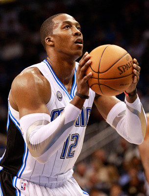 ORLANDO, FL - JANUARY 24:  Dwight Howard #12 of the Orlando Magic attempts a foul shot during the game against the Detroit Pistons at Amway Arena on January 24, 2011 in Orlando, Florida.  NOTE TO USER: User expressly acknowledges and agrees that, by downl