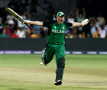 BANGALORE, INDIA - MARCH 02:  Kevin O'Brien of Ireland celebrates scoring a century batting against England in the Group B  2011 ICC World Cup match between England and Ireland at M. Chinnaswamy Stadium on March 2, 2011 in Bangalore, India.  (Photo by Gra