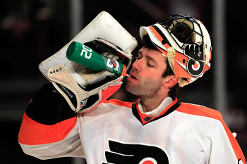NEW YORK, NY - FEBRUARY 20:  Brian Boucher#33 of the Philadelpia Flyers has a drink during the game against the New York Rangers at Madison Square Garden on February 20, 2011 in New York City. The Flyers defeated the Flyers 4-2.  (Photo by Chris Trotman/G