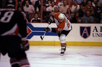 24 Apr 1998:  Center Chris Gratton of the Philadelphia Flyers in action against the Buffalo Sabres during an NHL playoff game at the Corestates Center in Philadelphia, Pennsylvania.  The Flyers defeated the Sabres 3-2. Mandatory Credit: Craig Melvin  /All