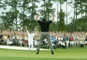 AUGUSTA, GA - APRIL 11:  Phil Mickelson jumps in the air after making birdie on the 18th hole to win the Masters by one shot during the final round of the Masters at the Augusta National Golf Club on April 11, 2004 in Augusta, Georgia.  (Photo by Andrew R