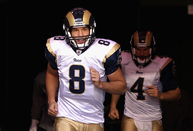 GLENDALE, AZ - DECEMBER 05:  Quarterback Sam Bradford #8 of the St. Louis Rams runs out onto the field before the NFL game against the Arizona Cardinals at the University of Phoenix Stadium on December 5, 2010 in Glendale, Arizona.  (Photo by Christian Pe