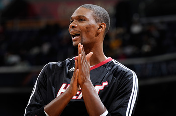 WASHINGTON, DC - DECEMBER 18:  Chris Bosh #1 of the Miami Heat warms up before the game against the Washington Wizards at the Verizon Center on December 18, 2010 in Washington, DC. NOTE TO USER: User expressly acknowledges and agrees that, by downloading