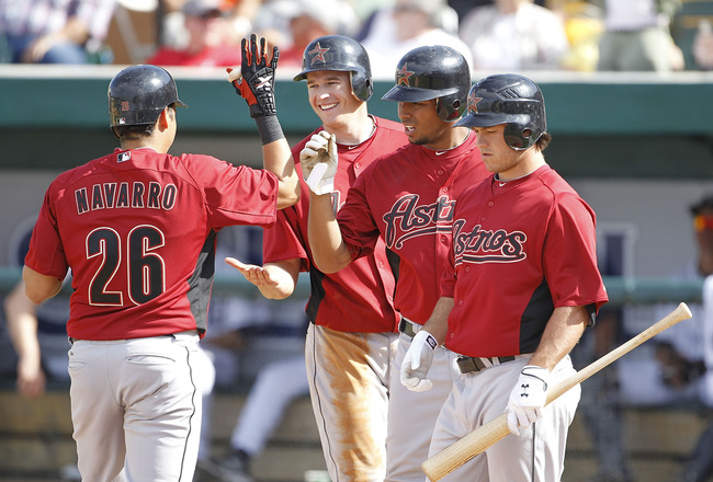 LAKELAND, FL - MARCH 02: Oswaldo Navarro #26 celebrates with his teammates T. J Steele #92 Angel Sanchez #36 and Koby Clemens #91 after hitting an eight inning three run home run  during the game against the Detroit Tigers at Joker Marchant Stadium on Mar