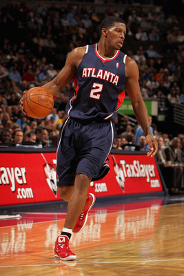 DENVER, CO - FEBRUARY 28:  Joe Johnson #2 of the Atlanta Hawks controls the ball against the Denver Nuggets during NBA action at the Pepsi Center on February 28, 2011 in Denver, Colorado. The Nuggets deafeated the Hawks 100-90. NOTE TO USER: User expressl