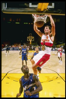 25 Oct 1997:  Matt Steigenga #6 of the Atlanta Hawks dunks the basketball over God Shammgod #2 of the Washington Wizards during the Hawks 102-96 loss at the Great Western Forum in Inglewood, California.  Mandatory Credit: Otto Greule  /Allsport