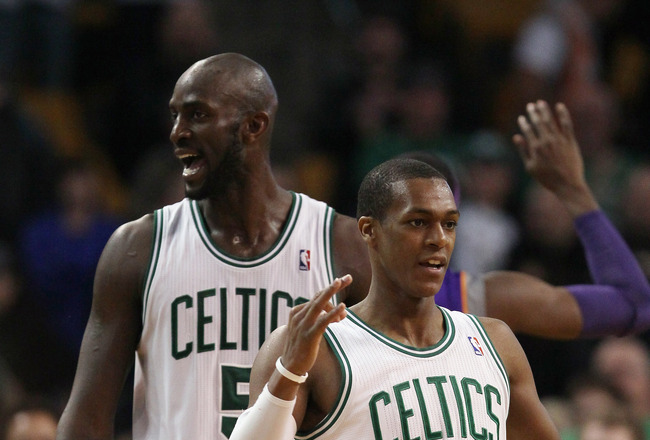 BOSTON, MA - MARCH 02:  Kevin Garnett and Rajon Rondo #9 of the Boston Celtics signal that Rondo has three shots after drew the foul in the final seconds of the game against the Phoenix Suns on March 2, 2011 at the TD Garden in Boston, Massachusetts.  The