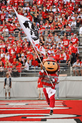 COLUMBUS, OH - SEPTEMBER 25:  Ohio State Buckeyes mascot Brutus Buckeye carries a flag during a game against the Eastern Michigan Eagles at Ohio Stadium on September 25, 2010 in Columbus, Ohio.  Ohio State won 73-20. (Photo by Jamie Sabau/Getty Images)