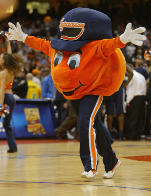 SYRACUSE, NY - JANUARY 24:  Otto the Orange, the Syracuse Orangemen mascot performs during the game against the Pittsburgh Panthers on January 24, 2004 at the Carrier Dome in Syracuse, New York. Pitt defeated the Orangeman 66-45. (Photo by Ezra Shaw/Getty