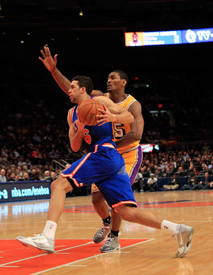NEW YORK, NY - FEBRUARY 11: Landry Fields #6 of the New York Knicks drives against Ron Artest #15 of the Los Angeles Lakers at Madison Square Garden on February 11, 2011 in New York City. NOTE TO USER: User expressly acknowledges and agrees that, by downl