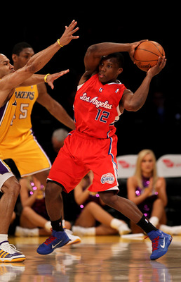 LOS ANGELES, CA - FEBRUARY 25:  Eric Bledsoe #12 of the Los Angeles Clippers controls the ball against Derek Fisher #2 of the Los Angeles Lakers at Staples Center on February 25, 2011 in Los Angeles, California. The Lakers won 100-88.  NOTE TO USER: User