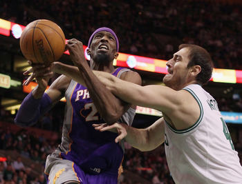 BOSTON, MA - MARCH 02:  Hakim Warrick #21 of the Phoenix Suns is fouled by Nenad Krstic #4 of the Boston Celtics on March 2, 2011 at the TD Garden in Boston, Massachusetts.  The Celtics defeated the Suns 115-103. NOTE TO USER: User expressly acknowledges