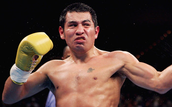 LAS VEGAS - NOVEMBER 27:  Marco Antonio Barrera (L) lands a left handed hook to the head of Erik Morales during a fight for the WBC World Super Featherweight Championship at the MGM Grand Garden Arena on November 27, 2004 in Las Vegas, Nevada. Barrera def