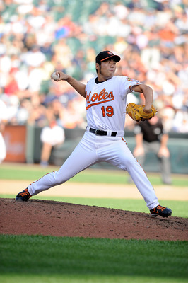BALTIMORE - SEPTEMBER 19:  Koji Uehara #19 of the Baltimore Orioles pitches against the New York Yankees at Camden Yards on September 19, 2010 in Baltimore, Maryland.  (Photo by Greg Fiume/Getty Images)
