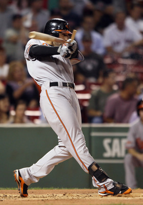 BOSTON - SEPTEMBER 22:  Nick Markakis #21 of the Baltimore Orioles breaks his bat in the first inning against the Boston Red Sox on September 22, 2010 at Fenway Park in Boston, Massachusetts.  (Photo by Elsa/Getty Images)