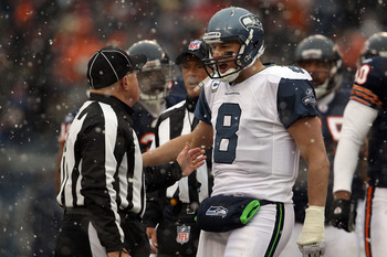 CHICAGO, IL - JANUARY 16:  Quarterback Matt Hasselbeck #8 of the Seattle Seahawks argues with a referee in the first half against the Chicago Bears in the 2011 NFC divisional playoff game at Soldier Field on January 16, 2011 in Chicago, Illinois.  (Photo