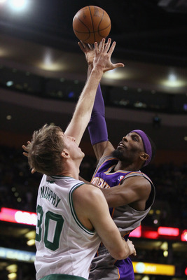 BOSTON, MA - MARCH 02:  Hakim Warrick #21 of the Phoenix Suns takes a shot as Troy Murphy #30 of the Boston Celtics defends on March 2, 2011 at the TD Garden in Boston, Massachusetts.  The Celtics defeated the Suns 115-103. NOTE TO USER: User expressly ac