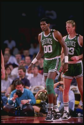 1990:  Center Robert Parish and forward Larry Bird of the Boston Celtics walk down the court during a game. Mandatory Credit: Tim de Frisco  /Allsport