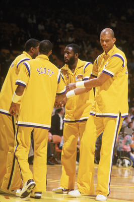 LOS ANGELES - 1988:  Magic Johnson #32, Byron Scott #4, James Worthy #42 and Kareem Abdul-Jabbar #33 of the Los Angeles Lakers huddle before an NBA game at the Great Western Forum in Los Angeles, California in 1988. (Photo by Jonathan Daniel/Getty Images)