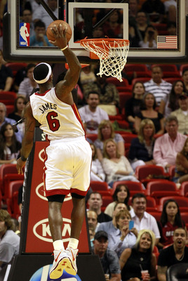 MIAMI, FL - MARCH 19:  Forward LeBron James #6 of the Miami Heat dunks against the Denver Nuggets at American Airlines Arena on March 19, 2011 in Miami, Florida. The Heat defeated the Nuggets 103-98. NOTE TO USER: User expressly acknowledges and agrees th