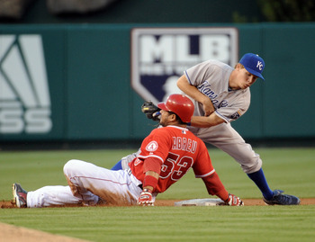 ANAHEIM, CA - AUGUST 10:  Chris Getz #17 of the Kansas City Royals applies a late tag on Bobby Abreu #53 of the Los Angeles Angels resulting in a double during the first inning at Angel Stadium on August 10, 2010 in Anaheim, California.  (Photo by Harry H