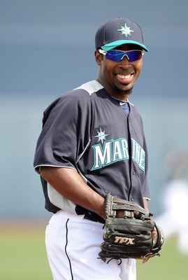 PEORIA, AZ - MARCH 01:  Chone Figgins #9 of the Seattle Mariners smiles as he warms up before the game against the Texas Rangers during spring training at Peoria Stadium on March 1, 2011 in Peoria, Arizona.  (Photo by Harry How/Getty Images)