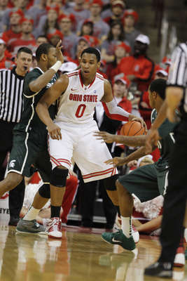 COLUMBUS, OH - FEBRUARY 15:  Jared Sullinger #0 of the Ohio State Buckeyes controls the ball while playing the Michigan State Spartans on February 15, 2011 at Value City Arena in Columbus, Ohio.  (Photo by Gregory Shamus/Getty Images)