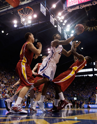 LAWRENCE, KS - FEBRUARY 12:  Marcus Morris #22 of the Kansas Jayhawks grabs a rebound during the game against the Iowa State Cyclones on February 12, 2011 at Allen Fieldhouse in Lawrence, Kansas.  (Photo by Jamie Squire/Getty Images)