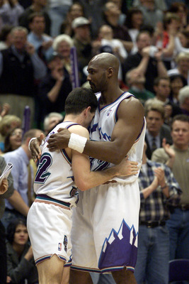 21 Apr 2001:  John Stockton #12 and Karl Malone #32 of the Utah Jazz celebrate after winning game one of the NBA playoffs against the Dallas Mavericks at the Delta Center in Salt Lake City, Utah.  The Jazz won 88-86.  DIGITAL IMAGE.  Mandatory Credit: Bri