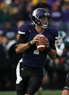 EVANSTON, IL - OCTOBER 23: Dan Persa #7 of the Northwestern Wildcats looks for a receiver against the Michigan State Spartans at Ryan Field on October 23, 2010 in Evanston, Illinois. Michigan State defeated Northwestern 35-27. (Photo by Jonathan Daniel/Ge