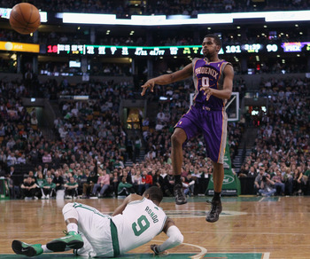 BOSTON, MA - MARCH 02:  Aaron Brooks #0 of the Phoenix Suns passes the ball over Rajon Rondo #9 of the Boston Celtics on March 2, 2011 at the TD Garden in Boston, Massachusetts.  The Celtics defeated the Suns 115-103. NOTE TO USER: User expressly acknowle