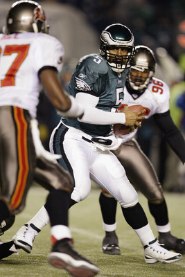 PHILADELPHIA - JANUARY 19:  Quarterback Donovan McNabb #5 of the Philadelphia Eagles is under extreme pressure by Defensive ends Ellis Wyms #96 and Simeon Rice #97 of the Tampa Bay Buccanneers during the NFC Championship game at Veterans Stadium on Januar