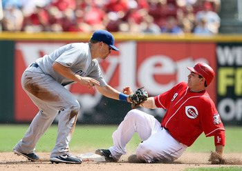 CINCINNATI - AUGUST 29:  Joey Votto #19 of the Cincinnati Reds slides safely into second base for a steal in front of the tag by Jeff Baker #28 of the Chicago Cubs during the game at Great American Ball Park on August 29, 2010 in Cincinnati, Ohio.  (Photo
