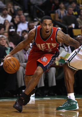 BOSTON - NOVEMBER 24:  Devin Harris #34 of the New Jersey Nets drives to the basket in the second half against the Boston Celtics on November 24, 2010 at the TD Garden in Boston, Massachusetts. The Celtics defeated the nets 89-83. NOTE TO USER: User expre